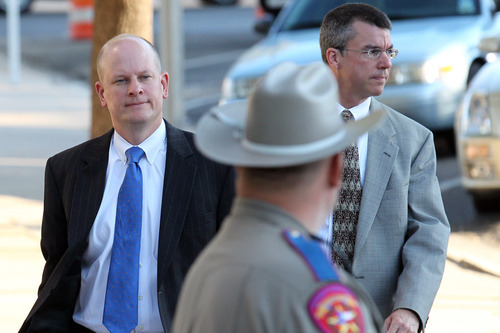 Special Prosecutor Eric Nichols, left,  arrives at the Tom Green County Courthouse Tuesday, Aug. 2, 2011 in San Angelo, Texas. Nichols said that the prosecution could rest today in the case against Warren Jeffs, leader of the polygamy-sanctioning Fundamentalist Church of Jesus Christ of Latter Day Saints.   Jeffs faces two counts of sexual assault of a child. The 55-year-old Jeffs claims his rights to religious freedom are being trampled. He is defending himself but gave no opening statement, hasn't cross-examined any state witnesses and isn't expected to call witnesses in his defense. (AP Photo/The San Angelo Standard-Times, Patrick Dove)
