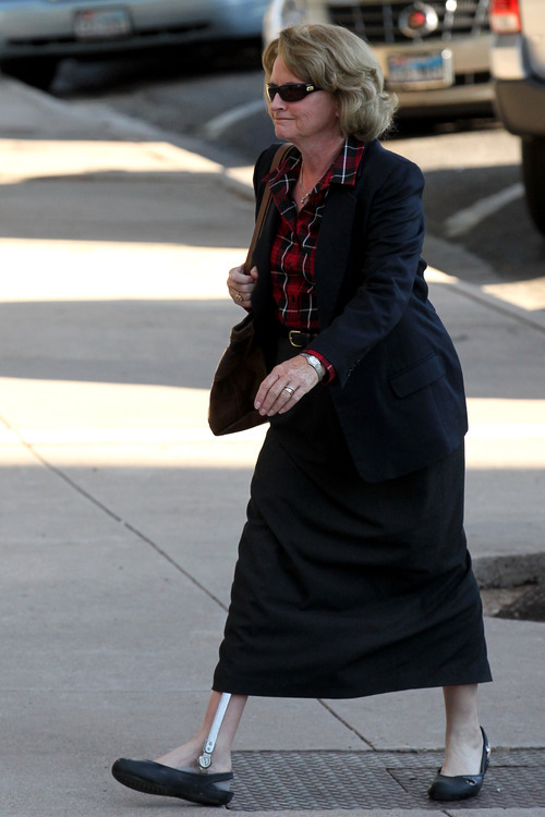 Judge Barbara Walther arrives at the Tom Green County Courthouse Tuesday, Aug. 2, 2011 for the seventh day of the Warren Jeffs trial in San Angelo, Texas.  Jeffs faces two counts of sexual assault of a child. The 55-year-old Jeffs claims his rights to religious freedom are being trampled. He is defending himself but gave no opening statement, hasn't cross-examined any state witnesses and isn't expected to call witnesses in his defense.  (AP Photo/San Angelo Standard-Times, Patrick Dove)