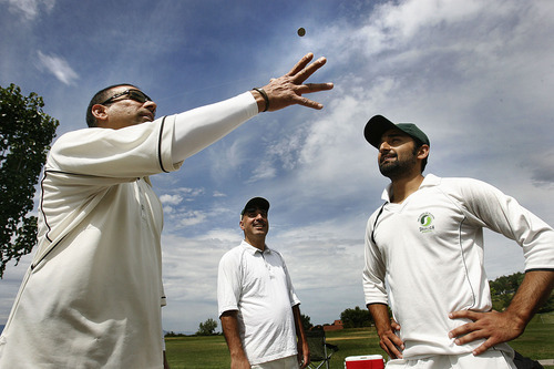 Scott Sommerdorf  |  The Salt Lake Tribune Salt Lake Cricket Union captain Nasir Khan (left), flips with opposing captain Omar Alam prior to match played Sunday July 31, 2011 at Terrace Hill Park in Salt Lake City.
