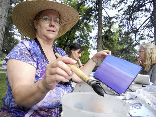 Suzanne Ashe | Special to The Salt Lake Tribune Art instructor Linda Moffitt demonstrates to how to build up a painting from a watercolor wash. Moffitt teaches watercolor painting through East High School Community Education.