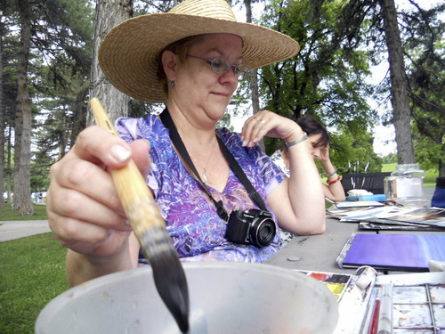 Suzanne Ashe | Special to The Salt Lake Tribune Art instructor Linda Moffitt rinses out her brush as she contemplates which color to choose next for her demonstration watercolor painting.