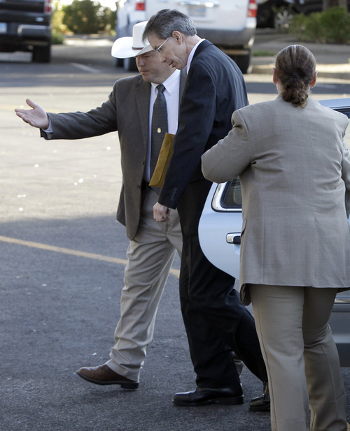 Law enforcement officials help polygamist leader Warren Jeffs out of a vehicle as he arrives at the Tom Green County Courthouse in San Angelo, Texas, on Thursday, Aug. 4, 2011.  Jeffs, 55, is  accused of sexually assaulting two girls he took as brides during so-called