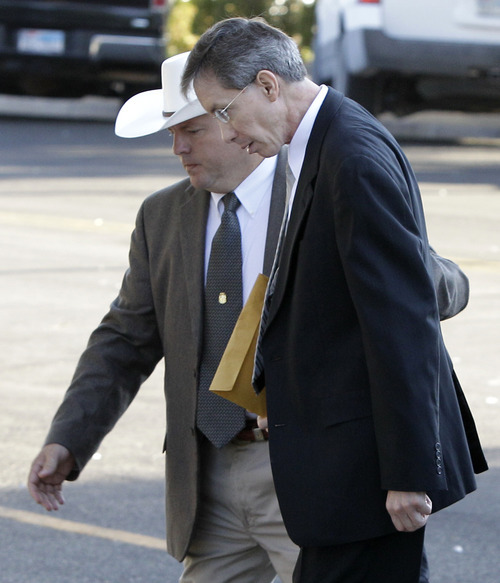 A law enforcement officer escorts polygamist leader Warren Jeffs into the Tom Green County Courthouse in San Angelo, Texas, on Thursday, Aug. 4, 2011. The defense rested Thursday in the sexual assault trial against Jeffs in which he served as his own defense. (AP Photo/Tony Gutierrez)