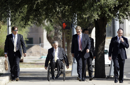 Texas Attorney General Greg Abbott, second from left, arrives at Tom Green County Courthouse for the sexual assault trial against Polygamist religious leader Warren Jeffs Thursday Aug. 4, 2011, in San Angelo, Texas.    Jeffs, 55, is  accused of sexually assaulting two girls he took as brides during so-called
