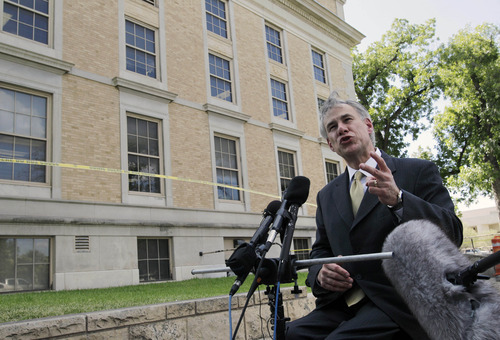 Texas Attorney General Greg Abbott responds to a reporters question after making a statement regarding the two guilty findings against Polygamist religious leader Warren Jeffs outside of the Tom Green County Courthouse Thursday Aug. 4, 2011, in San Angelo, Texas.  (AP Photo/Tony Gutierrez)