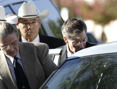 Law enforcement personnel place Polygamist religious leader Warren Jeffs into an awaiting vehicle as he departs the Tom Green County Courthouse Thursday Aug. 4, 2011, in San Angelo, Texas.  A jury convicted Jeffs of child sexual assault Thursday, in a case stemming from two young followers he took as brides in what his church calls