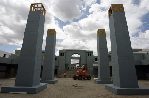 Francisco Kjolseth     The Salt Lake Tribune Four large obelisks, each to be topped (digitally) with a four-bowl menorah, are seen in the Court of the Women. Representatives of the LDS Church's Media Services department give a behind-the-scenes preview Monday of a new movie set near Goshen, Utah, that replicates parts of ancient Jerusalem. The set will be used to film a series of short New Testament vignettes that will be used by various church programs and departments. The sizable set, consisting of series of facades and backdrops that can be dressed to represent many different locations, is located approximately four miles south of Goshen in southern Utah County.