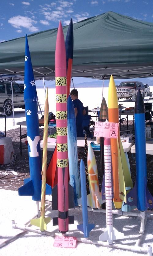 Cimaron Neugebauer  |  The Salt Lake Tribune Members of the Utah Rocket Club prepare model rockets to shoot off during their Hellfire event at the Bonneville Salt Flats on Thursday.