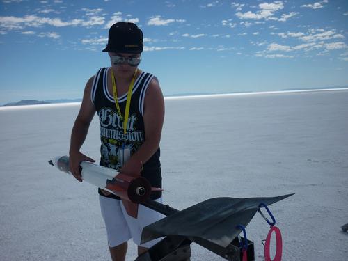 Cimaron Neuegebauer | The Salt Lake Tribune Chris Baker, 16, of Salt Lake sets up his homemade model rocket during the 16th Annual Utah Rocket Club's Hellfire event at the Bonneville Salt Flats on Thursday.