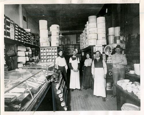 Salt Lake Tribune file photo  This undated photo shows Lettie Davis, left, Thomas Martin, Sarah Eliason, William Warneski and Axel Oleen in the Murray Co-op.