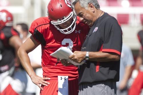 Chris Detrick  |  The Salt Lake Tribune Utah Ute quarterback Jordan Wynn talks with Norm Chow during a practice at Rice-Eccles Stadium Saturday August 6, 2011.
