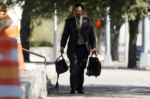 Defense attorney Deric Walpole walks to the Tom Green County Courthouse, Saturday, Aug. 6, 2011, in San Angelo, Texas, for the 11th day of the trial of polygamist religious leader Warren Jeffs, now in the penalty phase. Jeffs did not want to be present during the penalty phase so 51st District Judge Barbara Walther appointed Walpole to represent him. (AP Photo/ San Angelo Standard-Times, Patrick Dove)