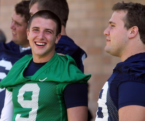 Rick Egan      The Salt Lake Tribune   BYU QB, Jake Heaps (9) smiles as he chats with Houston Reynolds, before taking the field for the opening of Fall Football Camp at BYU, Saturday, August 6, 2011