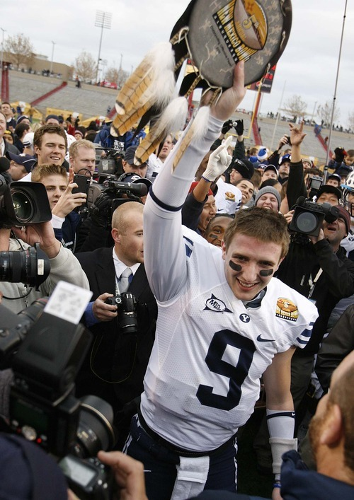Trent Nelson     The Salt Lake Tribune BYU quarterback Jake Heaps (9) holds the Outstanding Offensive Player award as BYU defeats UTEP in the New Mexico Bowl, college football Saturday, December 18, 2010 in Albuquerque, New Mexico.