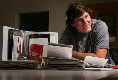Leah Hogsten  |  The Salt Lake Tribune Troy Hinds, a defensive end from Davis High School, is the most heavily recruited prospect in the state Friday, June 24 2011 in Kaysville. Hinds shows off his folders full of his awards, letters and memorabilia and serious offers to play for 15 colleges.
