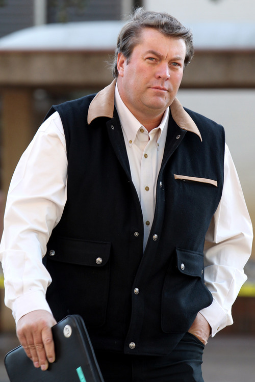 FILE - This Aug. 5, 2011 file photo shows Willie Jessop, a former member of the Fundamentalist Church of Jesus Christ of Latter Day Saints and follower of Warren Jeffs, walking to the Tom Green County Courthouse in San Angelo, Texas. Polygamous sect leader Warren Jeffs, to his followers a prophet who speaks directly with God, is likely to continue to lead his church from behind bars after being sentenced Tuesday Aug. 9, 2011 to life in prison on child sex assault charges. (AP Photo/San Angelo Standard-Times, Patrick Dove, File)
