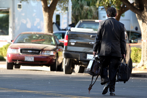 Deric Walpole, lead defense attorney for Warren Jeffs, walks back to his car at the end of court proceedings, Monday, Aug. 8, 2011, in San Angelo, Texas. Both the prosecution and defense rested their case in the penalty phase of the sexual assault trial of Jeffs, who was convicted on two counts of sexual assault of a child. Jeffs could get up to 119 years in prison. (AP Photo/San Angelo Standard-Times, Patrick Dove)