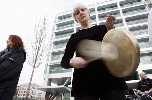 Francisco Kjolseth  |  The Salt Lake Tribune  Diana Hirschi, a member of Military Family Members Speak Out, strikes a gong as a small group gathers outside the Federal Building in Salt Lake City in 2008