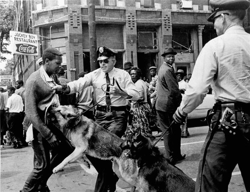 Bill Hudson  |  AP file photo A 17-year-old civil rights demonstrator, defying an anti-parade ordinance of Birmingham, Ala., is attacked by a police dog in this May 3, 1963 file photo. On the afternoon of May 4, 1963, during a meeting at the White House with members of a political group, President Kennedy discussed the photo which had appeared on the front page of that days New York Times,
