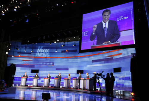 Republican presidential candidate former Massachusetts Gov. Mitt Romney is seen on screen during the Iowa GOP/Fox News Debate at the CY Stephens Auditorium in Ames, Iowa, Thursday, Aug. 11, 2011. (AP Photo/Charlie Neibergall, Pool)