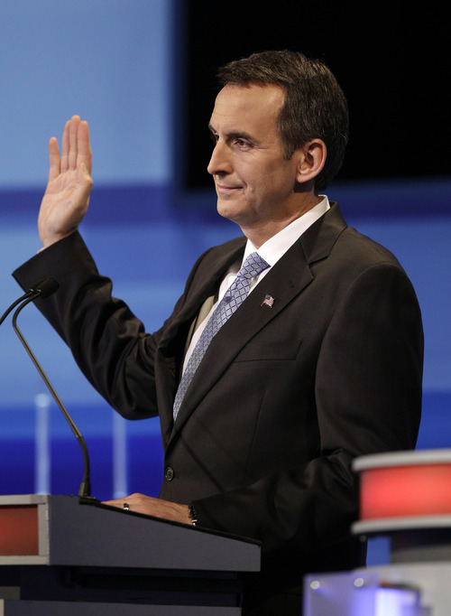 Republican presidential candidate former Minnesota Governor Tim Pawlenty gestures during the Iowa GOP/Fox News Debate at the CY Stephens Auditorium in Ames, Iowa, Thursday, Aug. 11, 2011. (AP Photo/Charlie Neibergall, Pool)