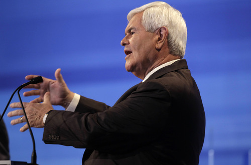 Republican presidential candidate former House Speaker Newt Gingrich speaks during the Iowa GOP/Fox News Debate at the CY Stephens Auditorium in Ames, Iowa, Thursday, Aug. 11, 2011. (AP Photo/Charlie Neibergall, Pool)