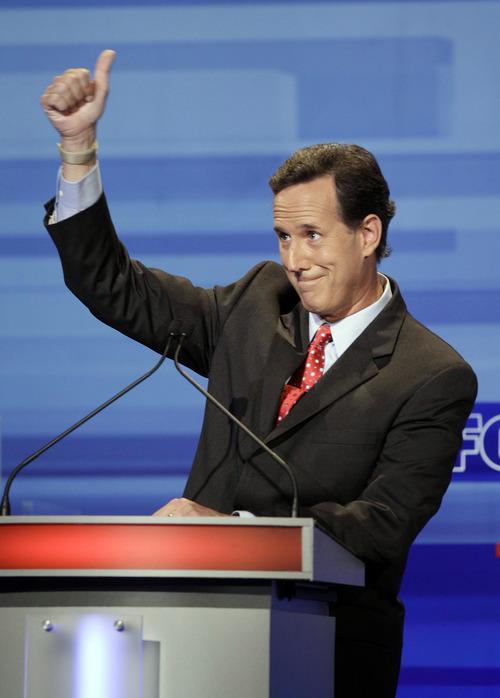 Republican presidential candidate former Pennsylvania Sen. Rick Santorum gestures during the Iowa GOP/Fox News Debate at the CY Stephens Auditorium in Ames, Iowa, Thursday, Aug. 11, 2011. (AP Photo/Charlie Neibergall, Pool)