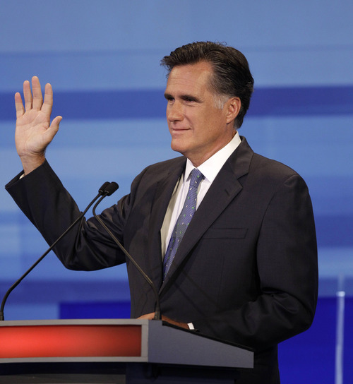 Republican presidential candidate former Massachusetts Gov. Mitt Romney gestures during the Iowa GOP/Fox News Debate at the CY Stephens Auditorium in Ames, Iowa, Thursday, Aug. 11, 2011. (AP Photo/Charlie Neibergall, Pool)