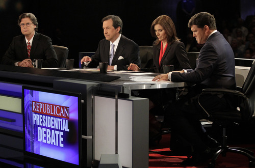 Debate moderators Byron York of The Washington Examiner, FOX News' Chris York, Susan Ferrechio of The Washington Examiner and FOX News' Brett Baier are seen before the start of the Iowa GOP/Fox News Debate at the CY Stephens Auditorium in Ames, Iowa, Thursday, Aug. 11, 2011.  (AP Photo/Charlie Neibergall)