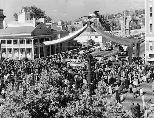Salt Lake Tribune file photo  A crowd gathers for the rededication of the Eagle Gate on State Street on Nov. 1, 1963. The gate had been knocked off its foundation when a truck crashed into it in 1960.
