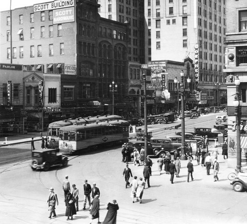 Salt Lake Tribune file photo  People and trolley cars make their way along Main Street in July, 1943.