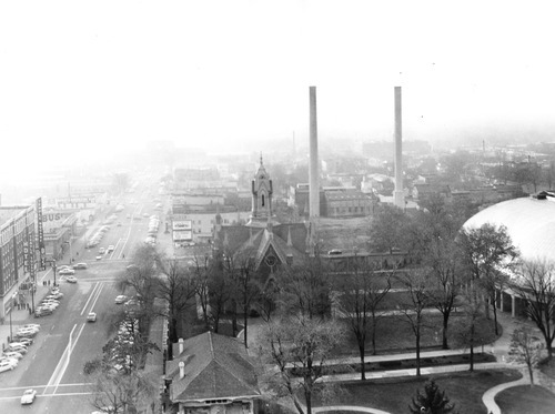Salt Lake Tribune file photo  Temple Square's Assembly Hall and Tabernacle are seen with smoke stacks looming in the background in this 1956 view of South Temple.