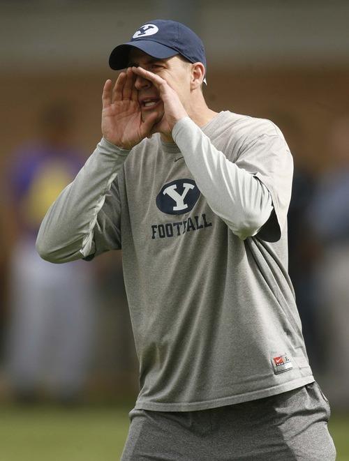 Trent Nelson     The Salt Lake Tribune BYU offensive coordinator Brandon Doman instructs his troops.