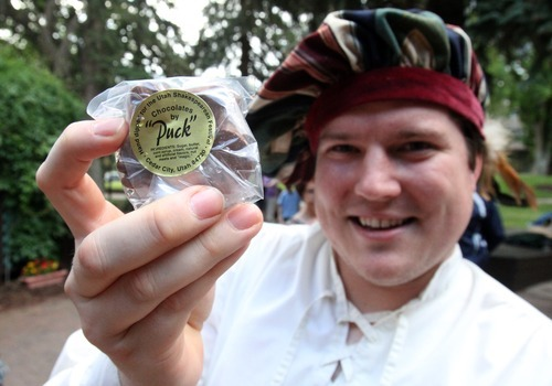 Rick Egan   |  The Salt Lake Tribune  Jeremy Heins sells Chocolates by Puck, made by Walt Price, of Salt Lake City, at the Utah Shakespeare Festival, Friday, July 8, 2011.