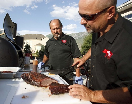 Trent Nelson  |  The Salt Lake Tribune Rod Livingston, right, inspects a freshly-cooked pork brisket. Livingston and his twin brother Roger from Alpine are the R&R BBQ Team that will represent Utah at several national BBQ events later this year.