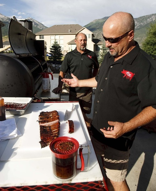 Trent Nelson  |  The Salt Lake Tribune Rod Livingston, right, and his twin brother Roger from Alpine are the R&R BBQ Team that will represent Utah at several national BBQ events later this year.