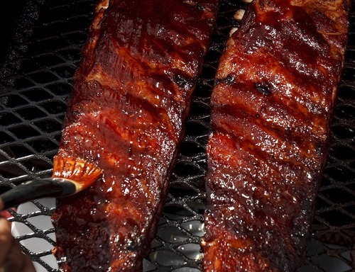 Trent Nelson  |  The Salt Lake Tribune Ribs, tended to on the smoker's grill. Rod Livingston and his twin brother Roger from Alpine are the R&R BBQ Team that will represent Utah at several national BBQ events later this year.