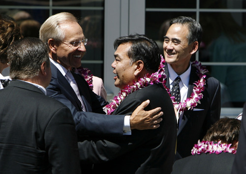 Francisco Kjolseth  |  The Salt Lake Tribune Craig Zwick, left, of the Quorum of the Seventy of The Church of Jesus Christ of Latter-day Saints, embraces Ken Okazaki with his brother Robert Okazaki in background during funeral services for their mother Chieko Nishimura Okazaki, the first non-Caucasian member of any LDS general board or presidency, at the LDS Holladay South Stake Center on Wednesday, August 10, 2011.