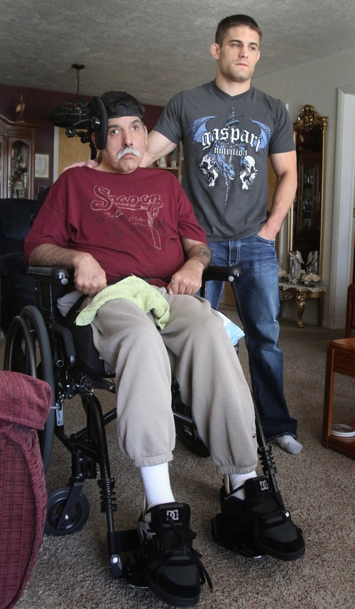 Rick Egan   |  The Salt Lake Tribune  Rad Martinez, a former college wrestler and rising star in mixed martial arts, cares for Richard, his father, at his home in West Jordan, Tuesday, August 9, 2011.  HIs father sustained a severe brain injury in an auto accident some 12 years ago.