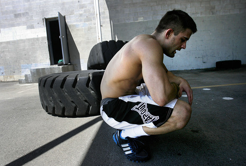 Scott Sommerdorf  |  The Salt Lake Tribune MMA fighter Rad Martinez takes a breather after pushing a weighted