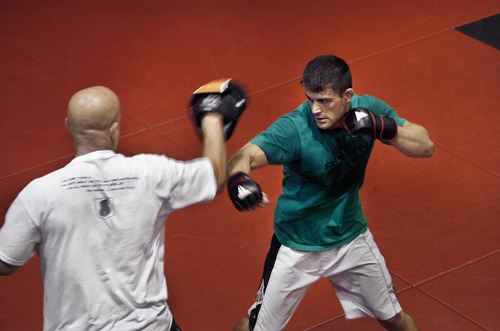 Scott Sommerdorf  |  The Salt Lake Tribune MMA fighter Rad Martinez of West Jordan (right), went through the paces of his MMA sparring session with coach Jason Mertlich at the Riven Academy in Orem, Thursday, August 11, 2011.