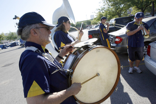 Francisco Kjolseth  |  The Salt Lake Tribune The Salt Lake Community College Summer Spirit Band warms up prior to the North Temple Viaduct opening celebration. From left, Lynn Brown, Miles Andrews, Austin Bushman and Cris Stiles play a few New Orleans classics to commemorate the reopening of the North Temple Viaduct on Wednesday, August 17, 2011.