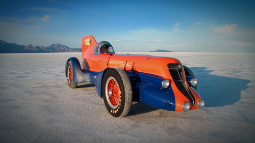 The restored Mormon Meteor III sits on the Bonneville Salt Flats. The history of the car, its creator Ab Jenkins, and how the salt flats became the world's place to break land-speed records, is covered in the documentary