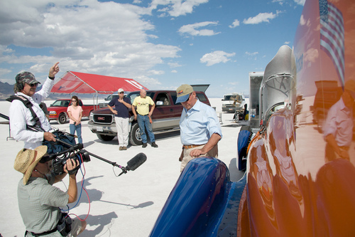John Price looks over the restored Mormon Meteor III during filming of the documentary