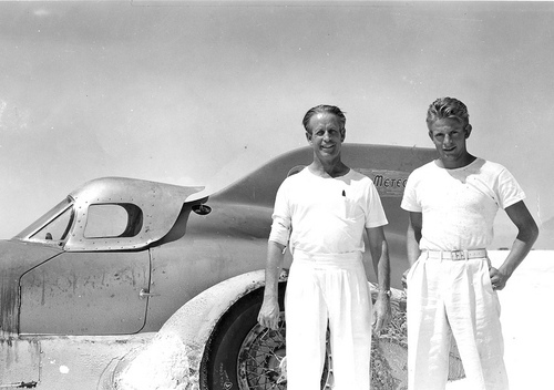 Racer Ab Jenkins (left) and his son Marv in front of the Mormon Meteor III on the Bonneville Salt Flats in 1940, when father and son raced the car at speeds approaching 200 mph. The image is seen in the documentary