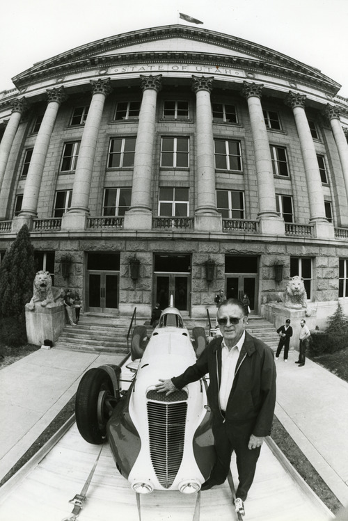 Tribune File Photo Marv Jenkins stands with the Mormon Meteor III in 1991, when his family reclaimed the famous car from the State of Utah for restoration.