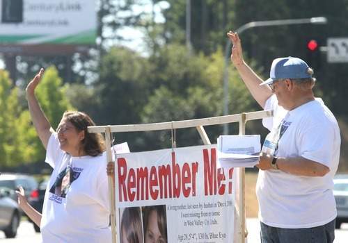 Rick Egan   |  The Salt Lake Tribune Judy and Chuck Cox, parents of Susan Powell, wave to cars in front of a shopping center in Puyallup, Wash., Saturday.