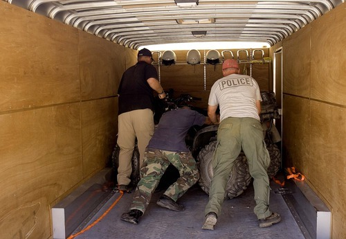 Trent Nelson  |  The Salt Lake Tribune Investigators with the West Valley City police department loaded ATVs into a trailer after spending the day searching abandoned mine shafts west Ely, Nevada, on Friday Aug. 19, 2011 as part of the investigation into the 2009 disappearance of Susan Powell.