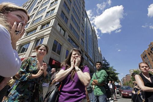Office workers gather on the sidewalk in downtown Washington, Tuesday, Aug. 23, 2011, moments after a 5.9 magnitude tremor shook the nation's capitol. The earthquake centered northwest of Richmond, Va., shook much of Washington, D.C., and was felt as far north as Rhode Island and New York City.  (AP Photo/J. Scott Applewhite)