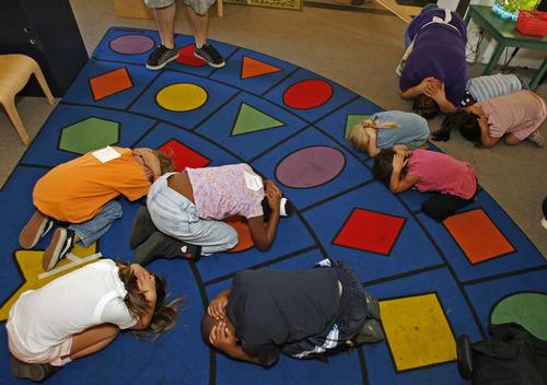 FILE - In this Nov. 13, 2008 file photo, school children practice their